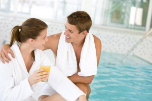 Young-happy-couple-relax-at-swimming-pool-000013539282_Double